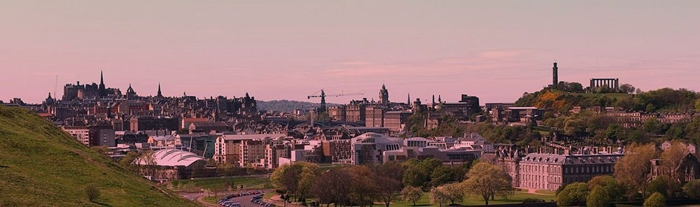 A panoramic view of Edinburgh with the Castle, Parliament and Holyrood Palace in view.